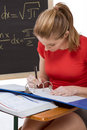 Caucasian schoolgirl by desk studying math exam Royalty Free Stock Photo