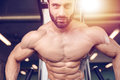 Caucasian sexy fitness model in gym close up abs Royalty Free Stock Photo
