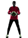 Caucasian soccer player goalkeeper man holding ball silhouette one standing in white background Royalty Free Stock Photos