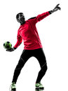 Caucasian soccer player goalkeeper man throwing ball silhouette one in isolated white background Royalty Free Stock Photos