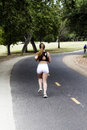 Caucasian Teen Girl Running On Bike Path In Shorts Royalty Free Stock Photo