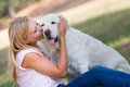 Caucasian teenager girl with old senior labrador dog in the park Royalty Free Stock Photo