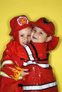 Caucasian twin boys dressed as firemen. Stock Images