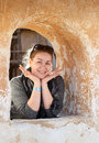 Caucasian woman in ancient wall window Royalty Free Stock Photo