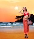 Caucasian woman in bikini dress young on the beach collage focus is on the figure of a girl Royalty Free Stock Photo