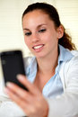 Caucasian woman browsing the internet on cellphone Royalty Free Stock Photo