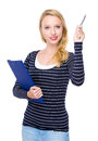 Caucasian woman with clipboard and pen up Royalty Free Stock Photo