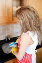 Caucasian woman doing the dishes Stock Photo