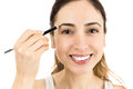 Caucasian woman using eyebrow pencil smiling make up applying isolated on white background Stock Photography