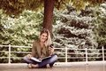 Caucasian woman using mobile phone outdoor.
