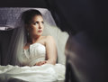 Caucasian young bride sitting in limo. Royalty Free Stock Photo