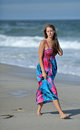 Caucasian young woman walking on the beach Royalty Free Stock Photo