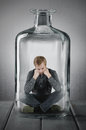 Caught in a bottle man is Royalty Free Stock Photos