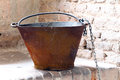 Cauldron in the kitchens of the castle antique copper medieval Royalty Free Stock Photo