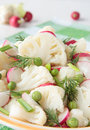 Cauliflower salad with radish and greens in bowl Royalty Free Stock Photography