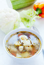 Cauliflower soup with vegetables in the background Royalty Free Stock Photos