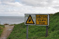 Caution cliff top sign on at swanage dorset Stock Images
