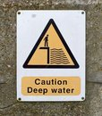 Caution deep water sign on wall Royalty Free Stock Image
