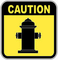 Caution fire hydrant Royalty Free Stock Image