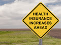 Caution health insurance increases ahead sign Stock Photos
