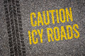 Caution icy roads lane with the text Royalty Free Stock Photography