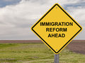 Caution immigration reform ahead sign Stock Photos