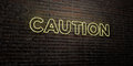 CAUTION -Realistic Neon Sign on Brick Wall background - 3D rendered royalty free stock image