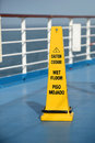 Caution sign on cruise ship wet floor sing deck of Royalty Free Stock Images