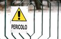 Caution sign with writing in italian big yellow Royalty Free Stock Photography