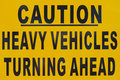 Caution signboard a warning on heavy vehicles movement at a construction site Royalty Free Stock Photo