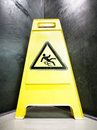 Caution slippery surface sign wet floor at a corridor Stock Images