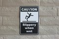 Caution slippery when wet sign Royalty Free Stock Photo