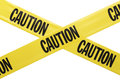 Caution tape yellow plastic criss crossing isolated on white background Royalty Free Stock Photo