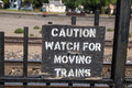 Caution train sign watch for moving trains in livingston montana Royalty Free Stock Image