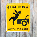 Caution watch for cars pedestrian sign Stock Photo