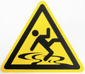 Caution wet floor sign at a sidewalk Stock Image