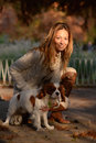 Cavalier King Charles Spaniel dog and a girl are together in the park enjoying beautiful autumn day Royalty Free Stock Photo