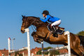 Cavallo rider jump blue girl Fotografia Stock