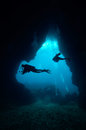 Cave and divers thailand in clear water Stock Photos