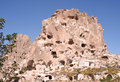 Cave dwellings and old castle in uchisar cappadocia turkey Stock Photo