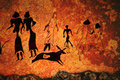 Cave painting of primitive commune Stock Photos