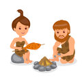 Caveman male kindles fire female cook the fish on the fire character prehistoric people a white background in flat style Stock Photos