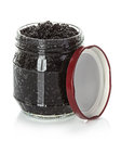 Caviar black in a glass jar isolated on white Royalty Free Stock Photo