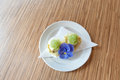 Caviar dessert garnished with purple flower on buiscuit garnish Stock Photos