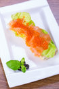 Caviar and smoked salmon sandwich red Stock Photography
