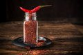 Cayenne pepper and Red peppers on old wooden table Royalty Free Stock Photo