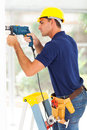 Cctv camera installer drilling wall Royalty Free Stock Photo