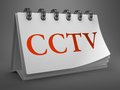 Cctv red word on desktop calendar white isolated gray background Royalty Free Stock Image