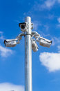 Cctv tv security camera on blue sky background Stock Images
