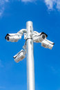 Cctv tv security camera on blue sky background rodeside Stock Image